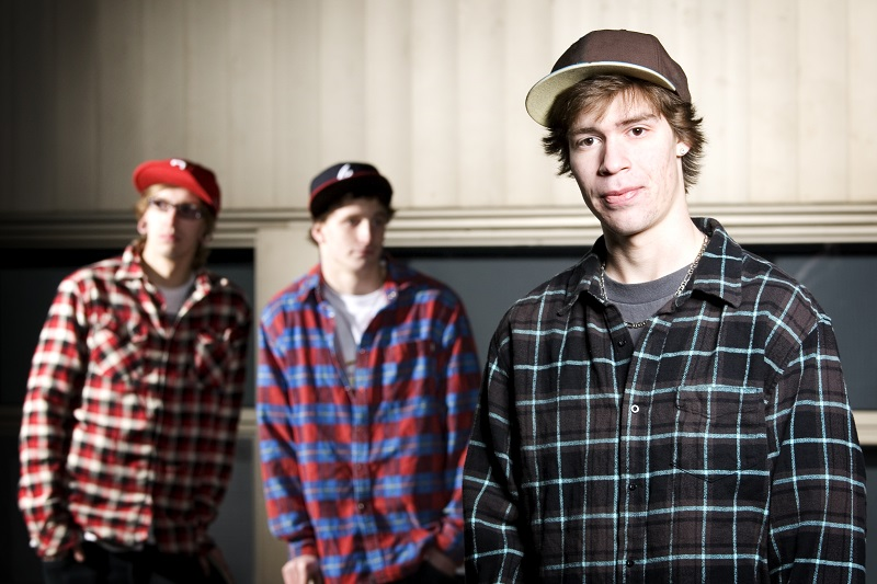 Three skateboarder kids standing together